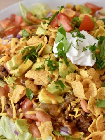 Frito Taco Salad in a white serving bowl.