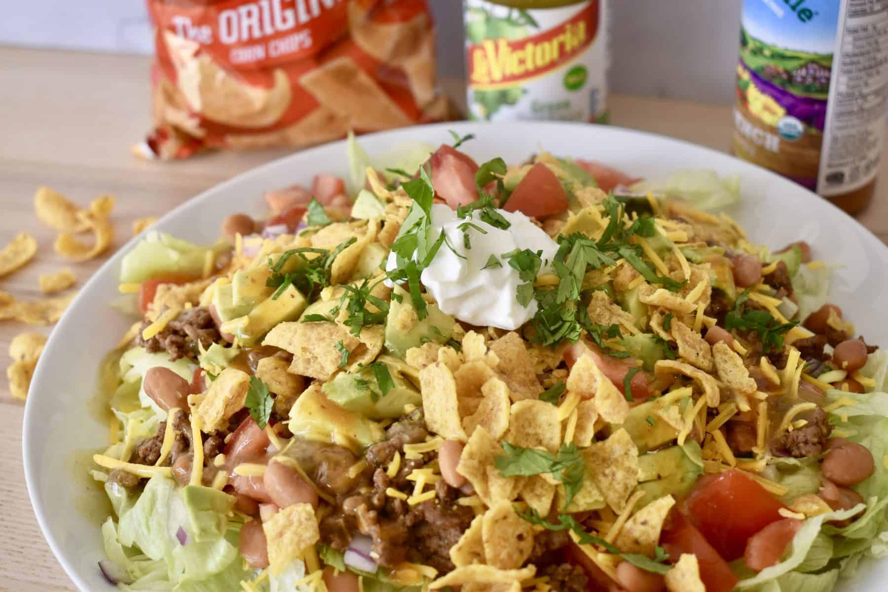 Frito Taco Salad with French dressing and green taco sauce.
