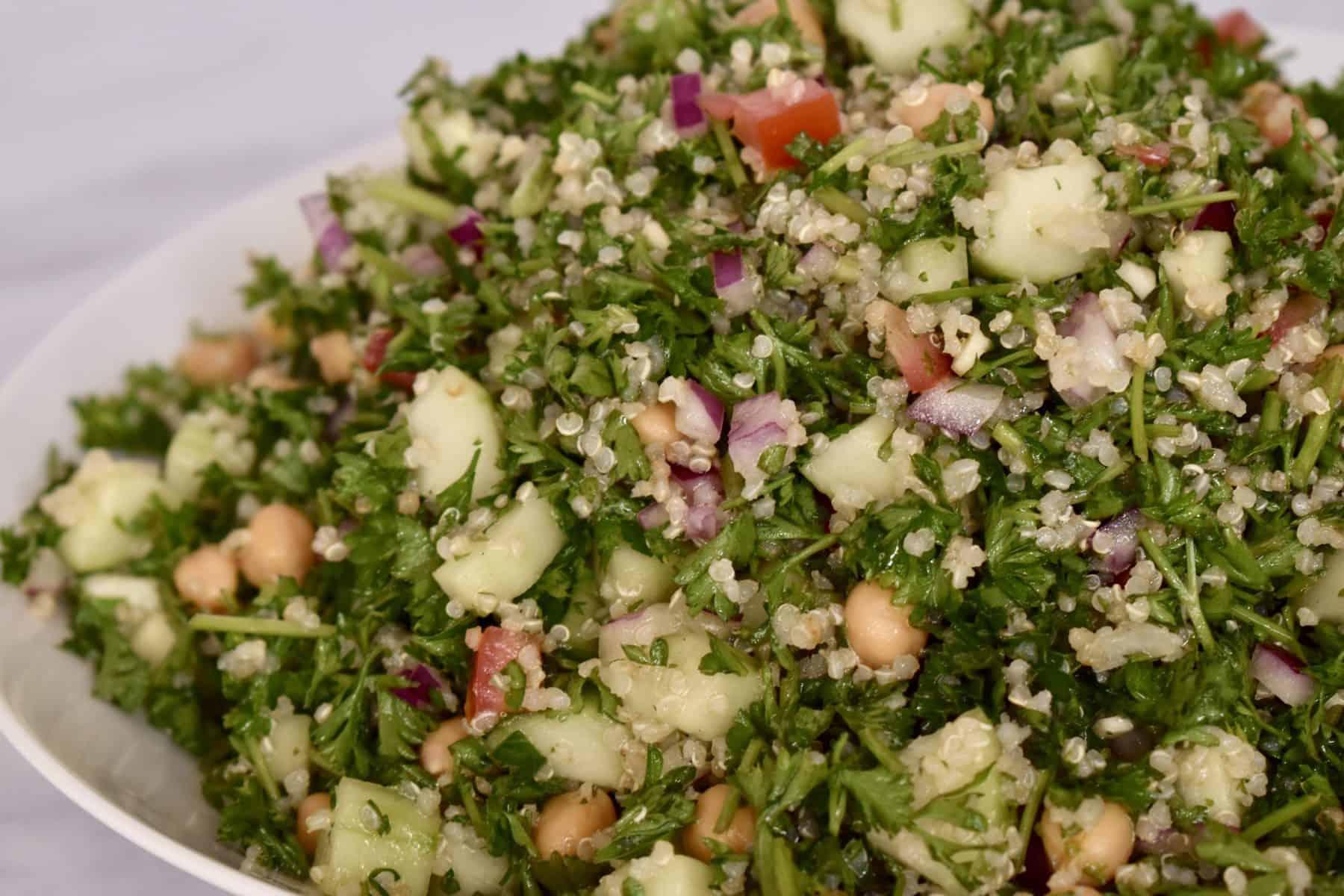 parsley quinoa chickpea salad is like tabbouli .