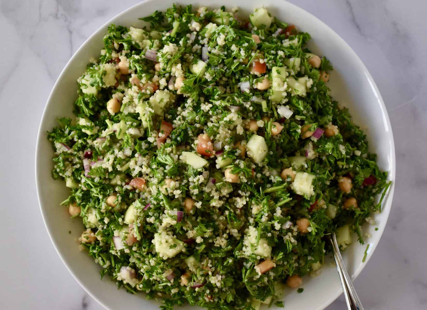 overhead photo of tabbouleh in a white bowl.