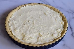 Mascarpone filling smoothed on top of the cooled olive oil tart crust.