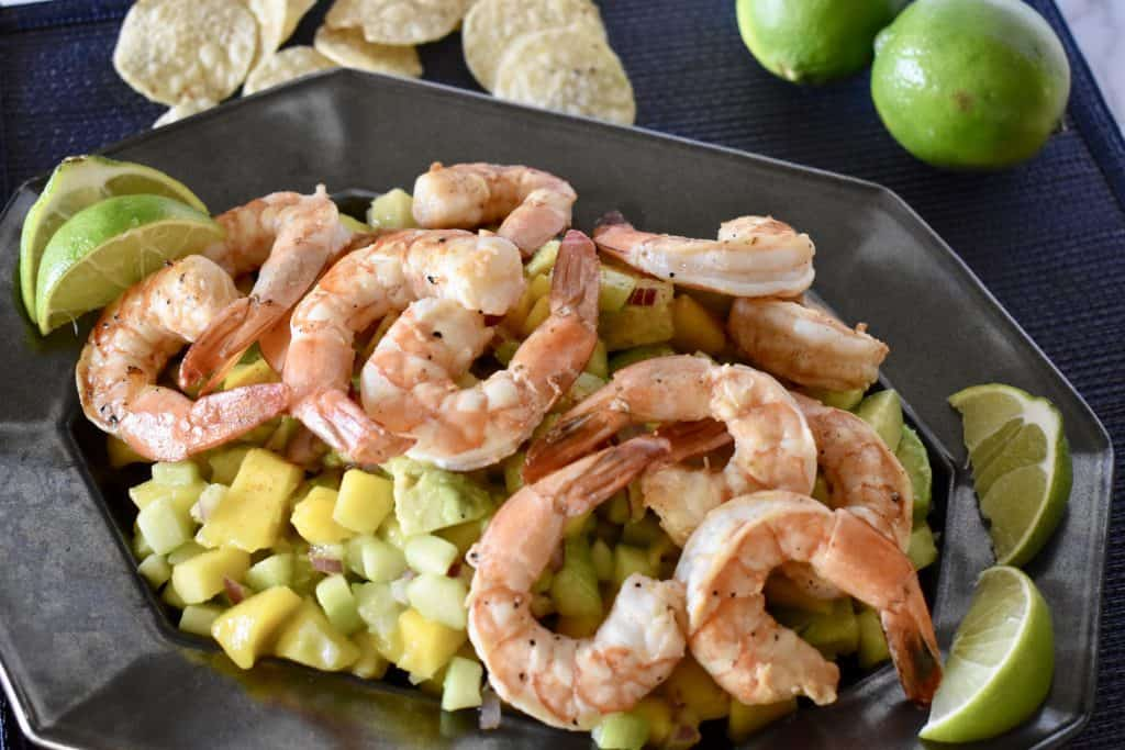 Shrimp on top of mango cucumber salad.