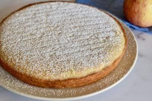 Almond Flour apple cake with powdered sugar sprinkled on top.
