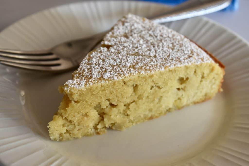 almond flour apple cake on a white plate.