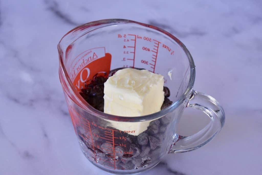 butter, chocolate chips, and corn syrup in a glass measuring cup.