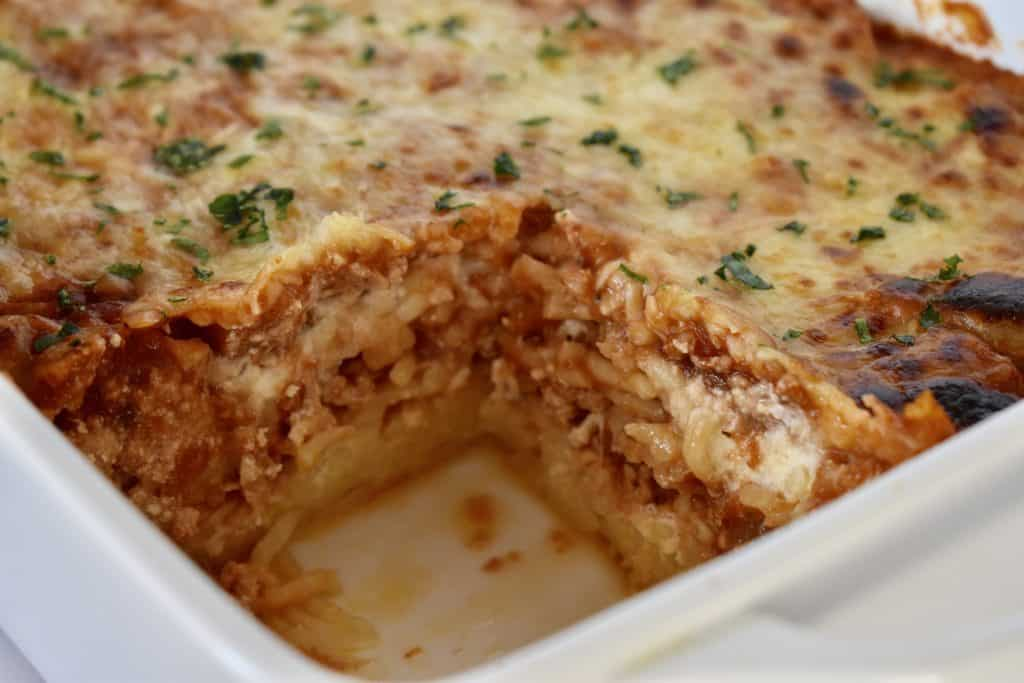 Baked Spaghetti with Ground Turkey in a white casserole dish.