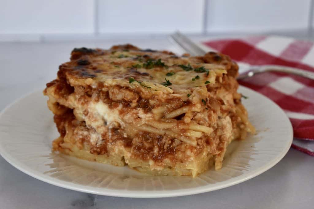 Baked Spaghetti with ground turkey on a plate.
