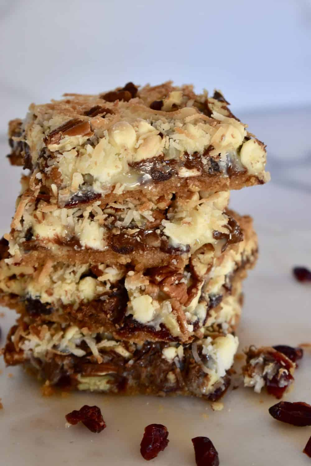 Cranberry magic bars with pecans and coconut.