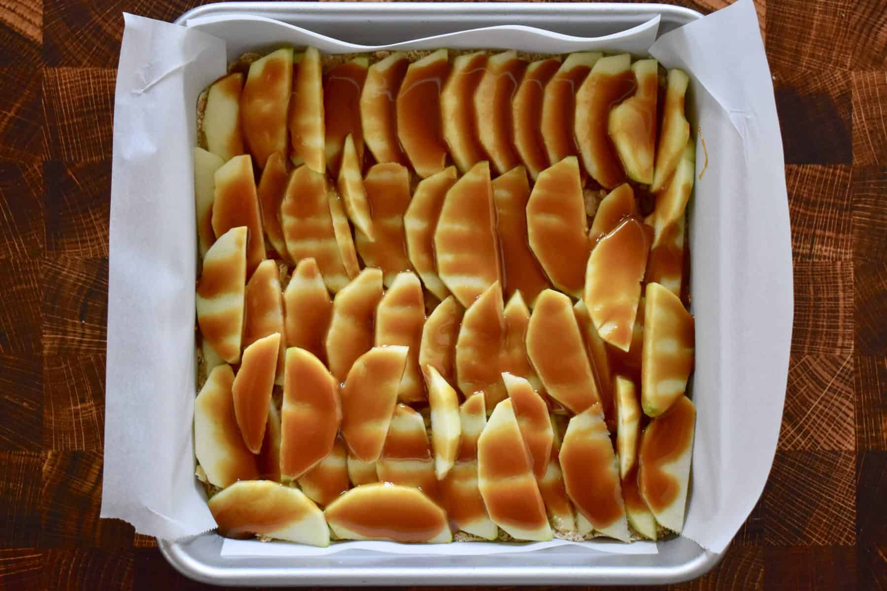 caramel sauce poured over the sliced apple layer.