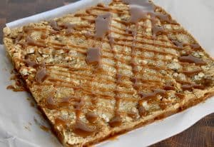 Caramel Apple Squares drizzled with caramel sauce.