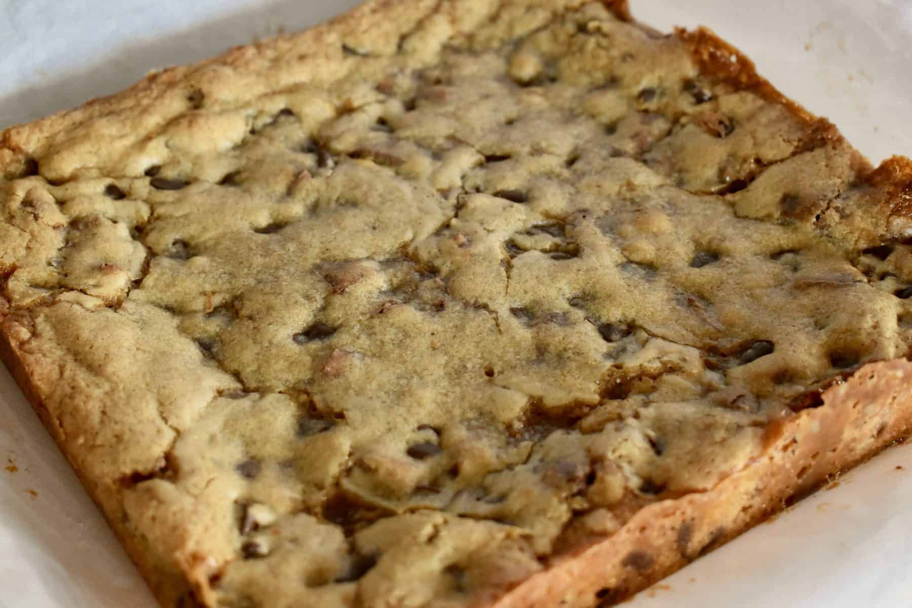 Baked Milky Way Blondies on white parchment paper.