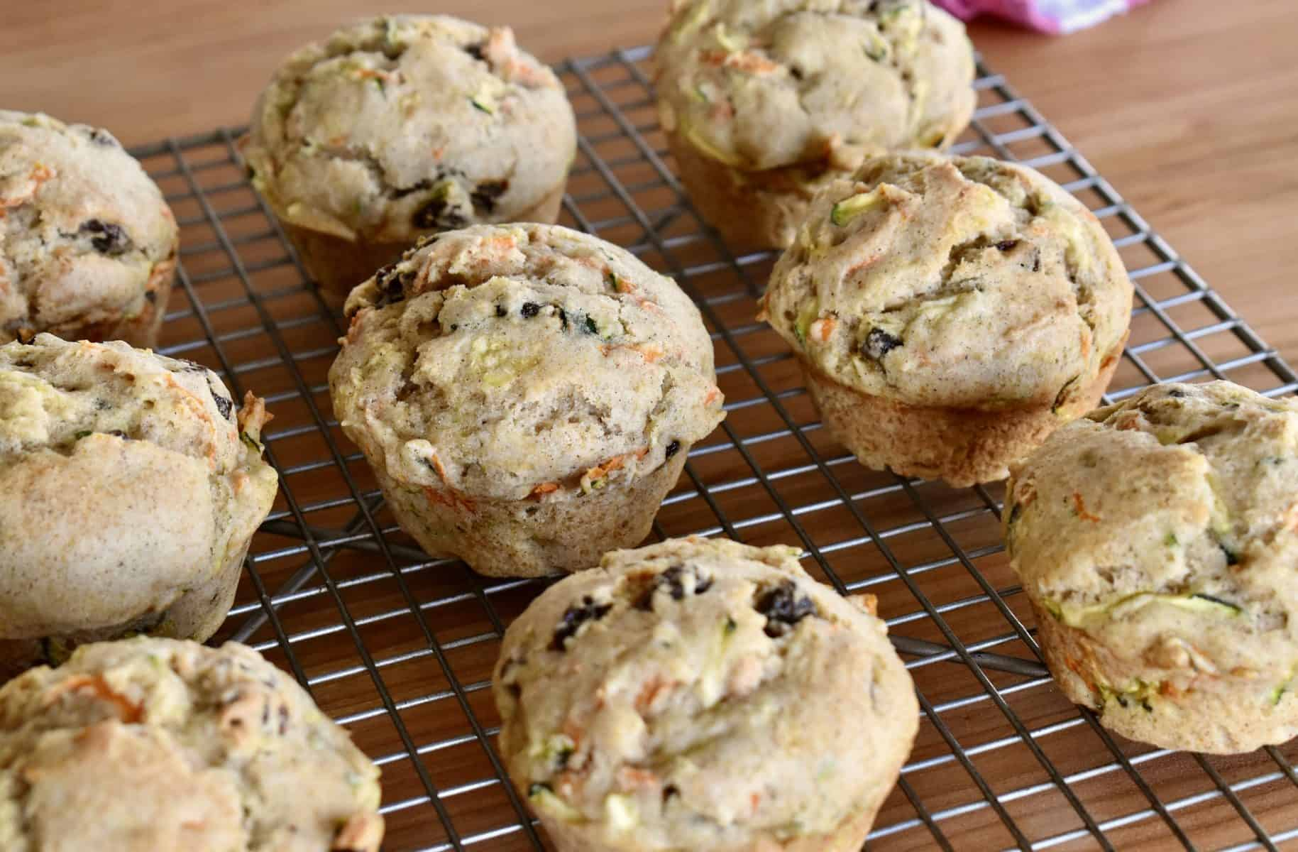 Zucchini Carrot Raisin Muffins on a cooling rack.