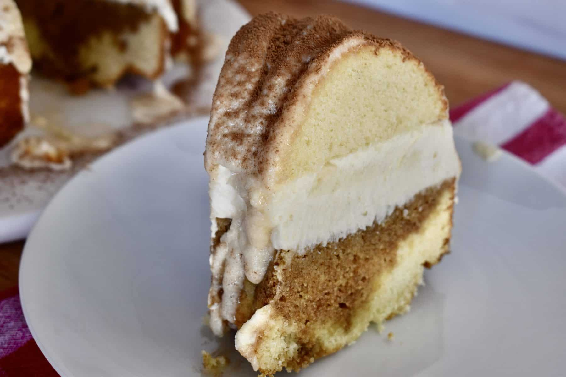 Slice of Tiramisu Bundt Cake on a white plate.