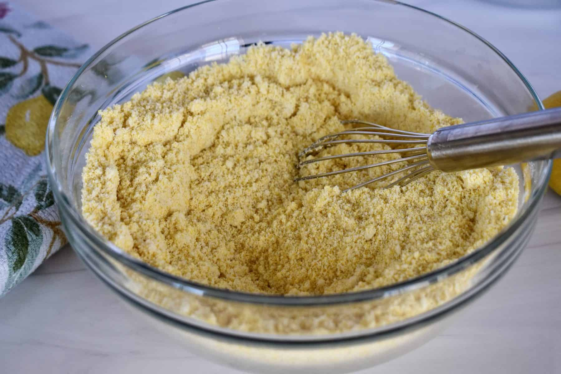 cornmeal and almond flour whisked together in a bowl.
