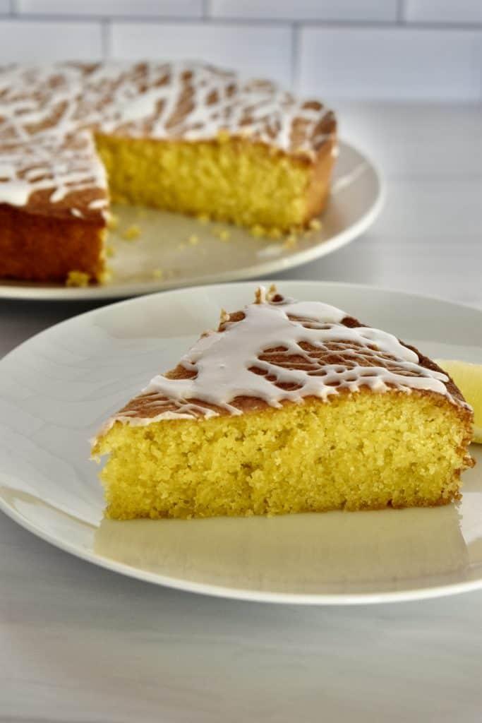 Lemon Polenta Cake on a white plate.