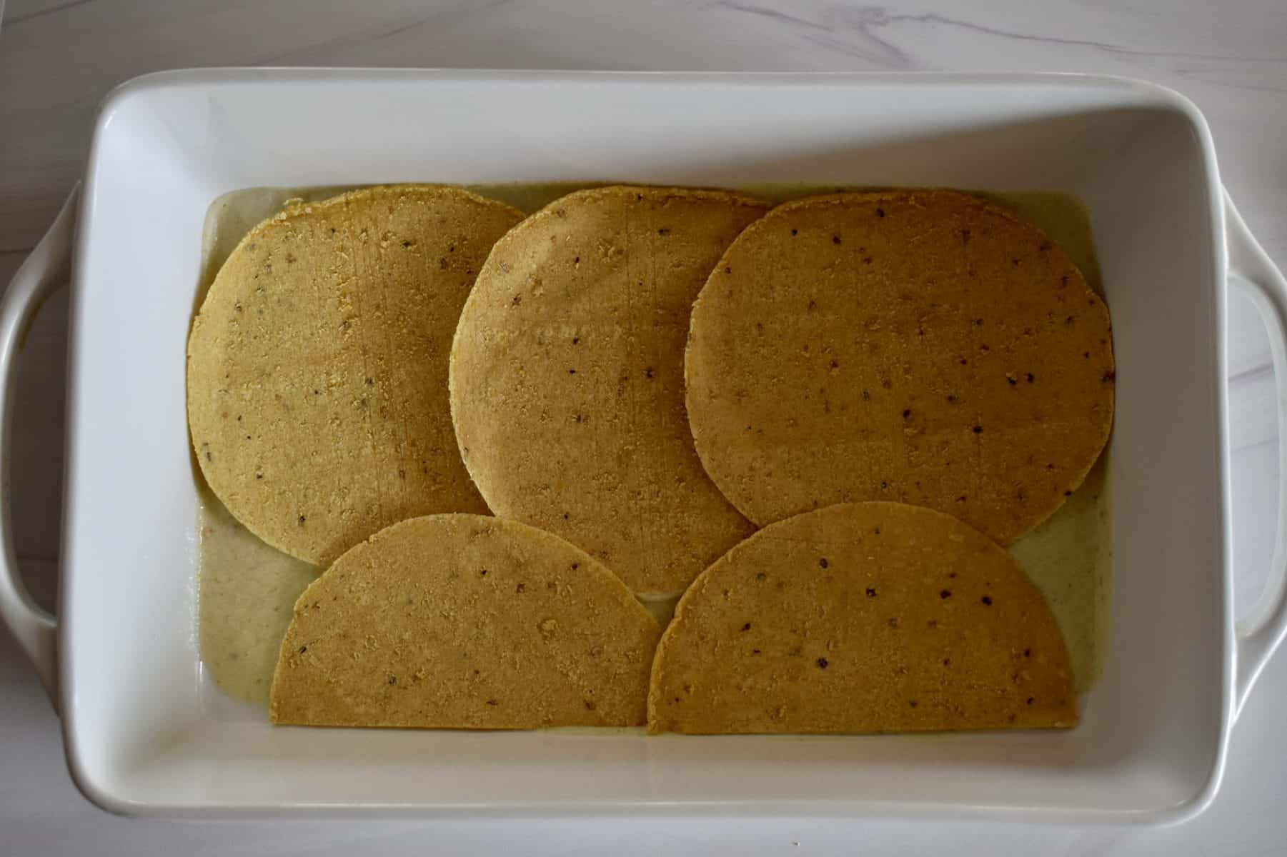 tortilla layered on the sauce.