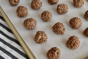 Balls of the mixture rolled on a cookie sheet.