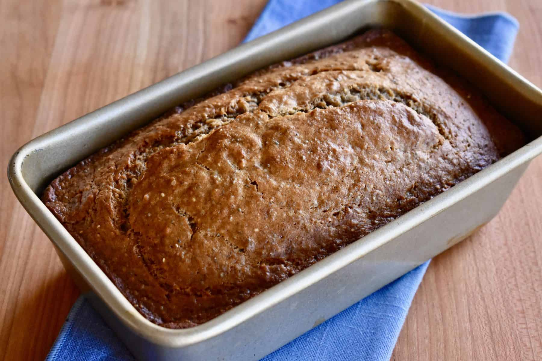 one bowl banana bread in a loaf pan.