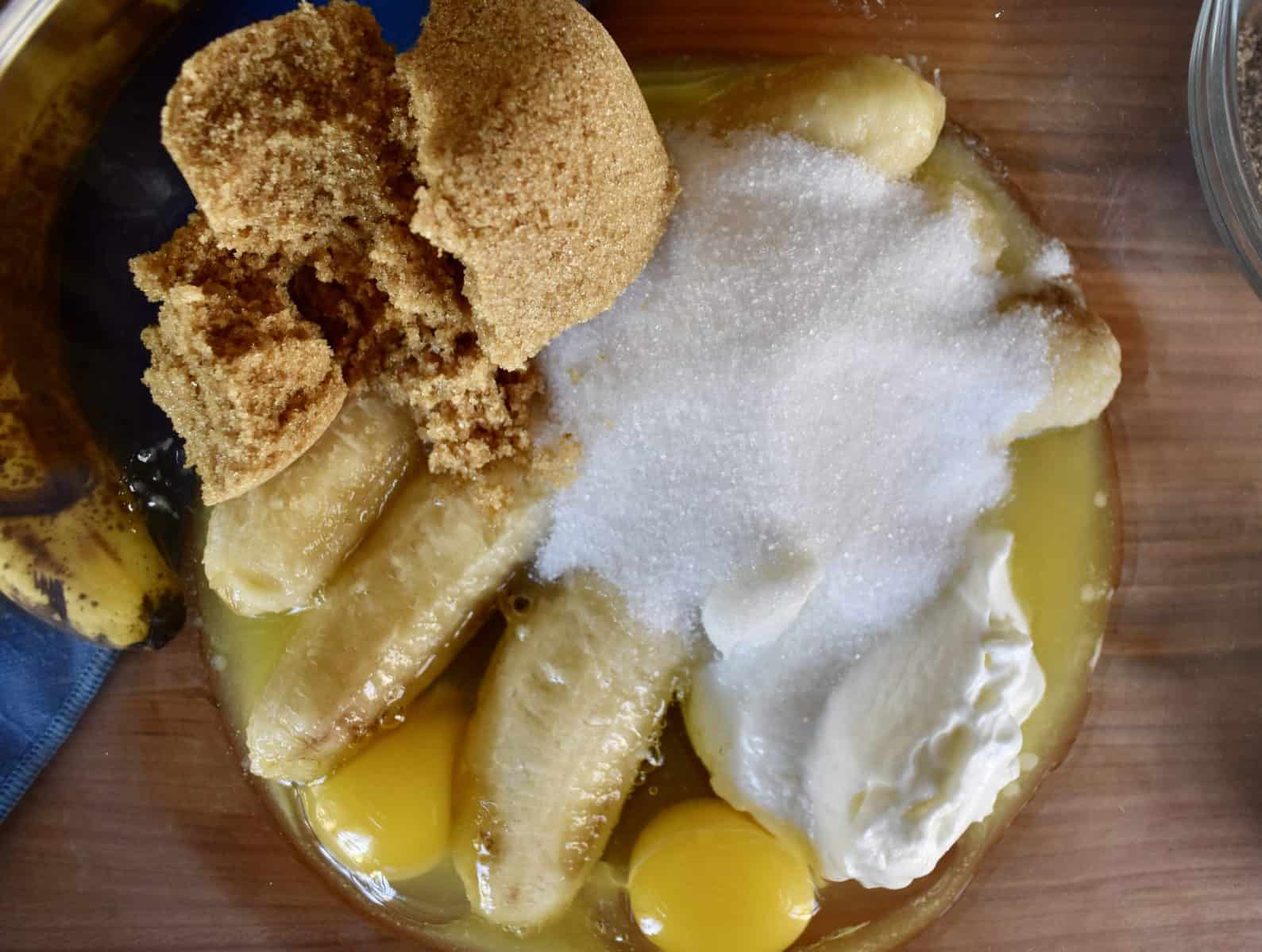 bananas, yogurt, butter, sugar, and eggs in a large mixing bowl.
