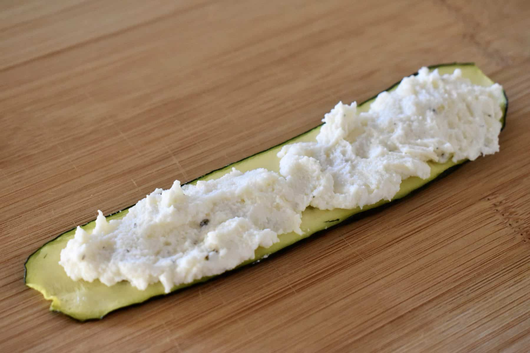 ricotta cheese mixture spread over top of the cooked zucchini slices.