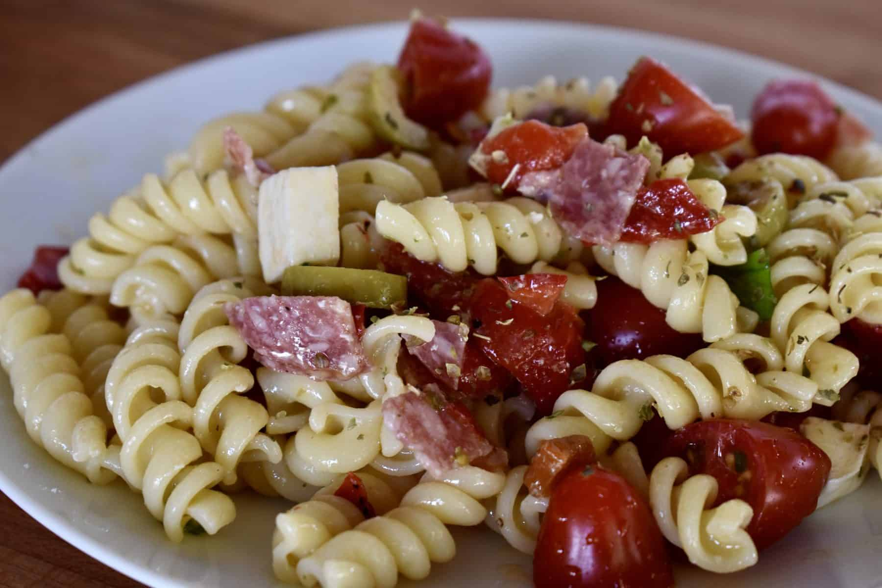Italian Pasta Salad on a white serving plate.