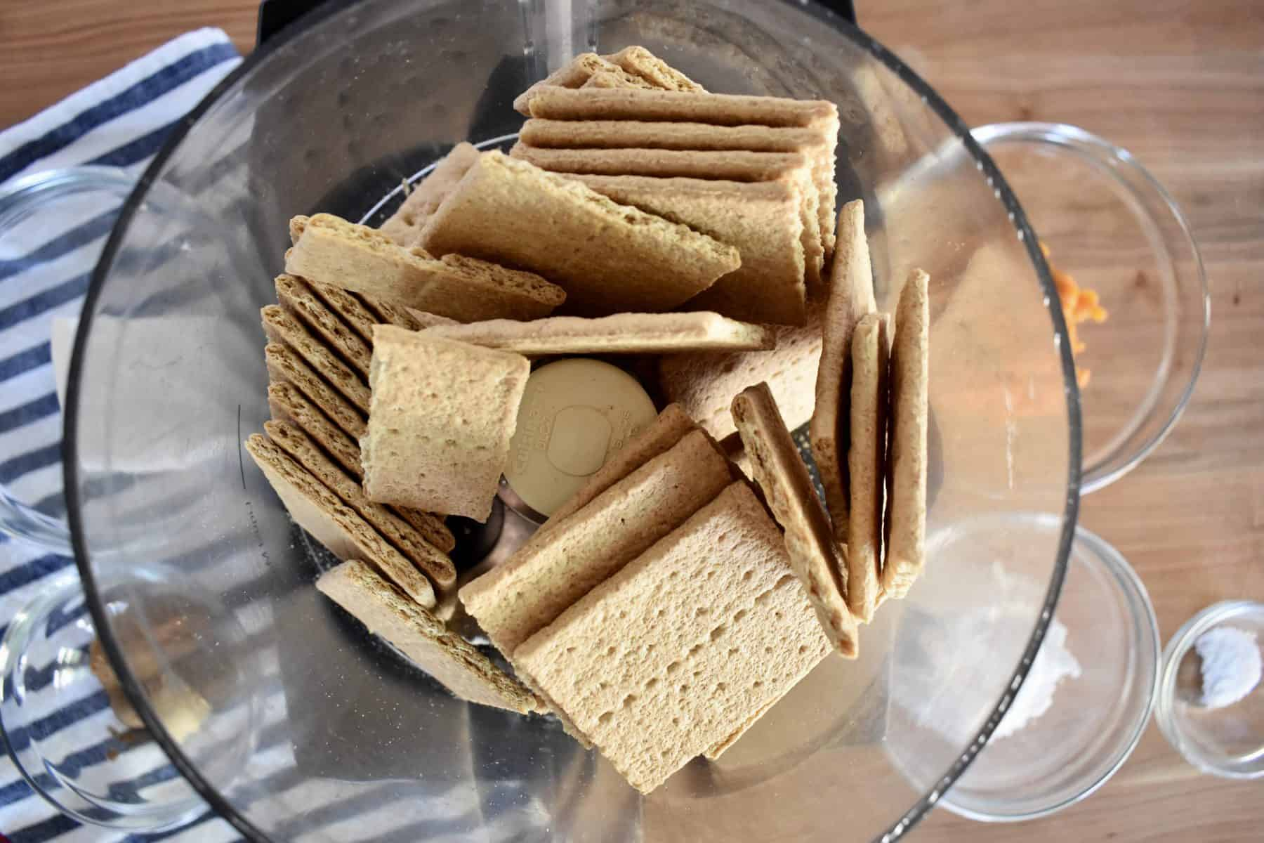 Overhead photo of graham crackers in a food processor.