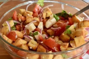 Bowl of Bruschetta Salad that has just been tossed with dressing.