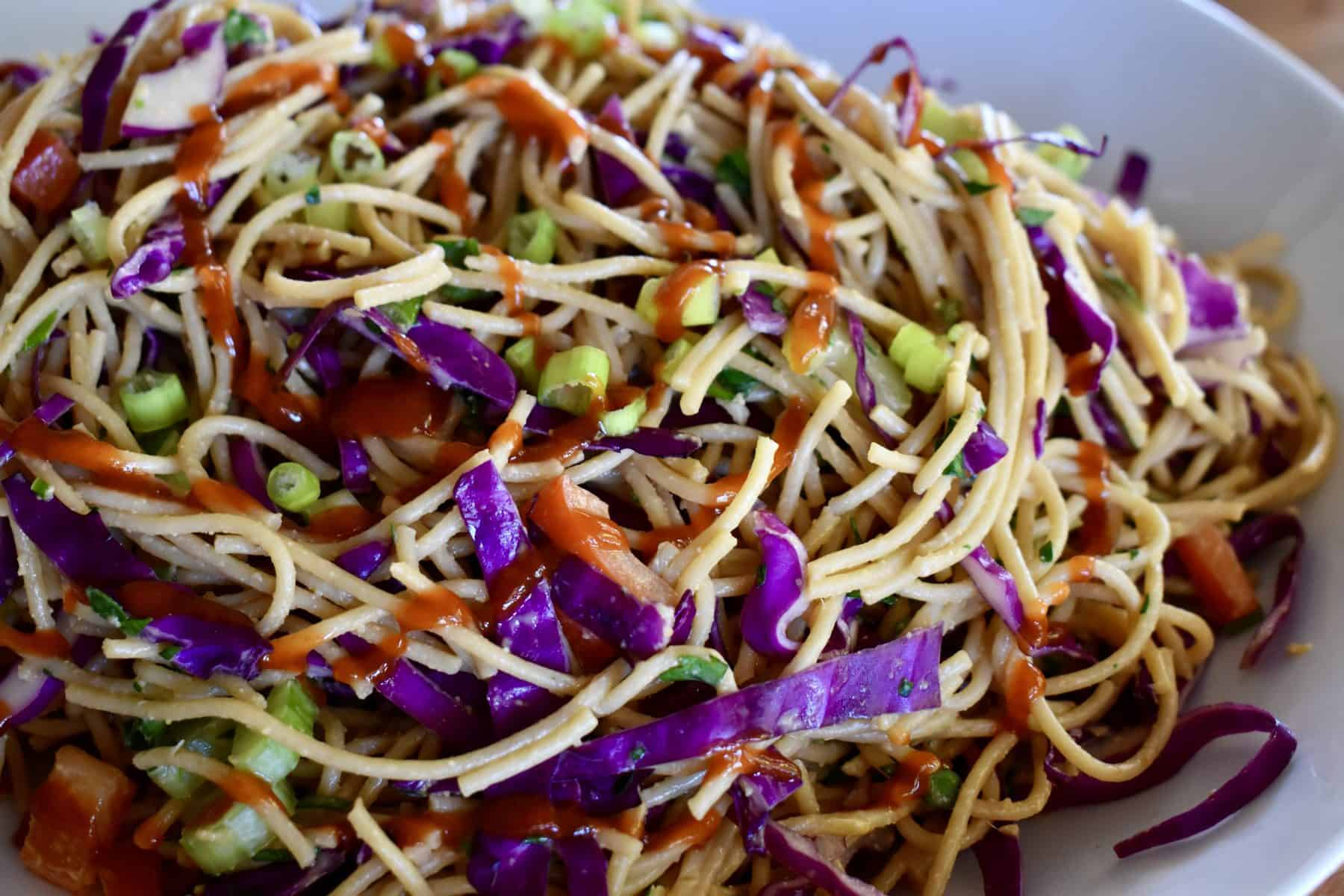 Cold Asian Noodle Salad in a white bowl.