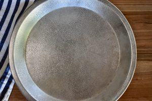 overhead photo of cookie pan sprayed with cooking spray.